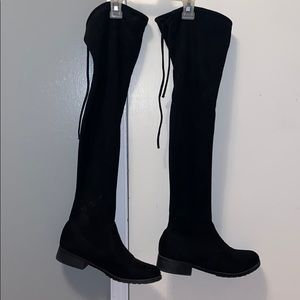 Black thigh high boots. Over the knee boots